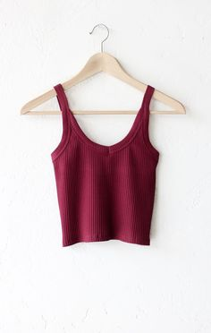 "- Description Details: Knit ribbed cami crop top in burgundy with v-neckline. Form fitting, tend to run on the smaller side & are more fitted. Measurements (Size Guide): S: 24"" bust, 15.5"" length M: 2"