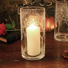 Glass Tree Etched Hurricane Candle HolderCreate a warm winter ambiance in your home with this beautiful glass hurricane lantern. Featuring a stunning tree etched design around the lantern. In a classic shape, for use with a standard church candle and perfect for creating mood lighting whilst dining, or adding a warm ambiance to a windowsill or mantlepiece. Free Gift Wrap and Gift Messaging Service available upon request.GlassH25cm