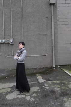 Daily Outfit: 50 Shades of Grey - black maxi dress, grey cashmere sweater, grey snakeskin scarf. [cable car couture]