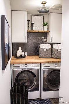 cheap room makeover Love this Small Laundry Room Makeover ! The modern black and white laundry room with wood accents looks so chic. Laundry Room Remodel, Laundry Room Cabinets, Laundry Decor, Laundry Room Organization, Laundry Room Design, Laundry Room Countertop, Tv Cabinets, White Laundry Rooms, Farmhouse Laundry Room