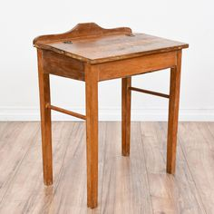 This small rustic desk is featured in a solid wood with a distressed light maple finish. This desk is in great vintage condition with a lift up top, a large interior storage space and simple straight legs. Perfect for storing books and work supplies! #rustic #desks #secretarydesk #sandiegovintage #vintagefurniture