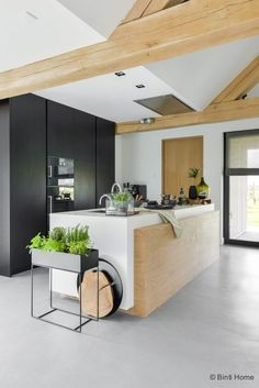 Beautiful use of wood to warm up this contemporary white kitchen