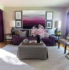 Purples, pinks and ethnic designs full of feminine look in one room. The mixture of purple hues on the beautiful wall hanging have spread out it's arms around the sofa, draperies and each and every corner of the room transforming it to a cozy and sophisticated living space, where anyone can feel relaxed.