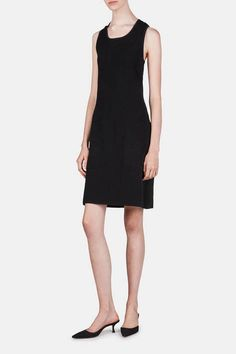 Each Edun piece represents the label's mission to support the artisans and entrepreneurs of Africa, and is also a versatile creation of the highest quality that can be worn in a variety of ways. That principled versatility is demonstrated in this sleeveless knit dress. In an especially sleek and stretchy merino wool blend, the pull-on style has a lean silhouette, strappy back with criss-cross straps, and front patch pockets.
