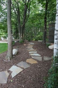"""""""Mulched areas beside lawn, under large trees""""  """"Unstructured stone walkway with ample mulched beds.""""  """"Big mulch bed w stone path""""  """"stone in mulched or mulched leaves""""  """"Not convinced I want mulch prefer pebbles?""""  """"Combo of materials, grass, patio stone, mulch""""  """"Mulch around trees with flagstone walking""""  """"black mulch for sideyard...""""  """"Stone, mulch trail...Flagstone on mulch...Good use of mulch...bark mulch"""""""