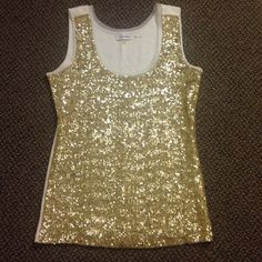 Calvin Klein sequin tank Beautiful, beautiful piece! Gold sequins on front of tank only Calvin Klein Tops Tank Tops