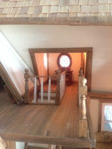 staircase ending in tower opened to attic - if false wall is added, the slant roof portion must be removed