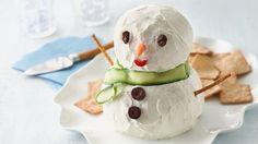 This adorable snowman is made of a delicious spread of seasoned cream and Cheddar cheeses.