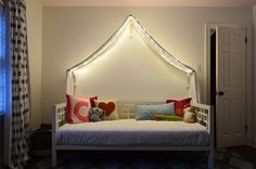 Young House Love | Adding Fairy Lights To A Canopy Bed (and Photoshop Fun) | http://www.younghouselove.com