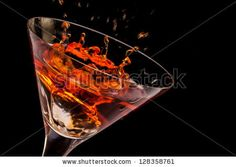 Sold! Stock photo available for sale at Shutterstock: Closeup of glass with splashing spritz on black background. - stock photo