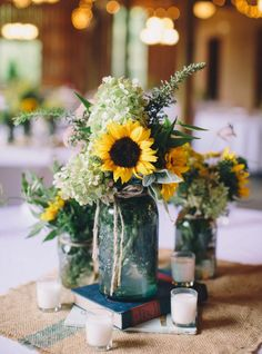 Love these mason jar bouquets, with books!