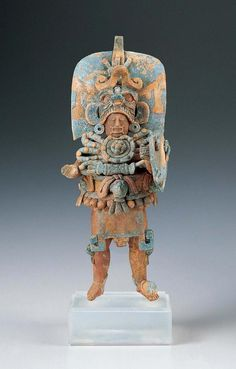 Standing Ruler | Kimbell Art Museum.Guatemala, Maya culture.Late Classic period (A.D. 600–900).c. A.D. 600–800.The surviving works of Maya civilization range from the smallest objects to great edifices. Among the small-scale artworks of the Maya are many exquisite ceramic figurines only a few inches high. Despite their diminutive scale, these are also among the most fully realized of Maya sculptures in the round. This figurine vividly evokes a Maya lord costumed to impersonate a dynastic…