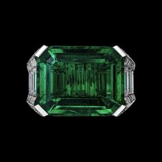 "CARTIER. ""Amazonie"" Ring - platinum, one 17.38-carat rectangular-shaped step-cut emerald from Colombia, baguette-cut diamonds, brilliant-cut diamonds. #Cartier #ÉtourdissantCartier #2015 #HauteJoaillerie #HighJewellery #FineJewelry #Emerald #Diamond"
