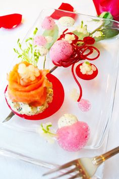 We call this sultry little appetizer From Russia with Love; smoked salmon with a potato salad in a light, grainy mustard dressing, grapefruit caviar, borscht jelly, asparagus sprouts, borscht spaghetti and a beet foam. #molecular  #gastronomy
