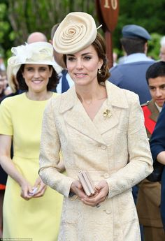 In keeping with the location of the party the Duchess also wore a golden shamrock brooch that was presented to her as a wedding gift from the Irish Guards