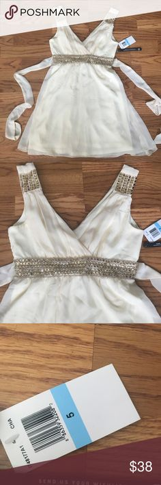 Cream and gold beaded dress . Dresses
