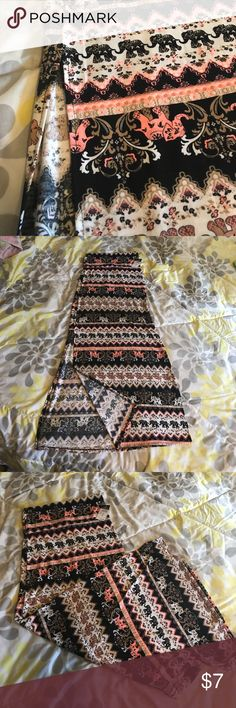 """Long double slit skirt Long double slit Bohemian elephant printed skirt, pink, beige, white and black. Approximately 38"""" long. I purchased this and it was too small for me. New with tags. Rue 21 Skirts High Low"""