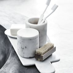 marble pots for toothpaste and brushes...