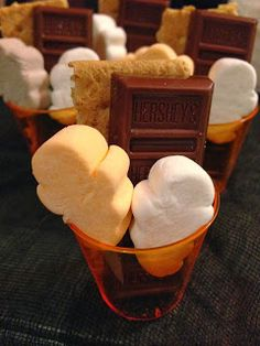 Halloween S'mores Shots.  Place 1 Graham Cracker, 1 Mini Hersey's Bar and 2 Ghost Marshmallows in an orange shot glass and you have a simply scrumptious s'mores shots.