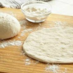 Thin Crust Pizza dough in bread machine - https://whatscookingamerica.net/Bread/PerfectThinCrustPizza.htm