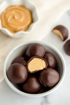 A white bowl filled with peanut butter balls and a small bowl of peanut butter in the background. Peanut Butter Filling, Peanut Butter Balls, Peanut Butter Recipes, Coconut Recipes, Fun Baking Recipes, Candy Recipes, Sweet Recipes, Cookie Recipes, Dessert Recipes