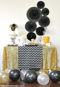 Buy a length of shimmery fabric and use as table covering and also on a tension rod in window for backdrop for pictures