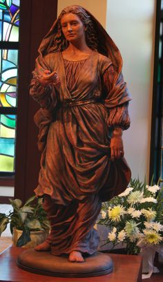 Our Lady of Welcome, also known as our Lady of Hope, is located at the front entrance of St. Edna Church in Arlington Heights, Illinois.