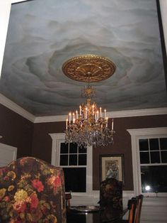 Seems that whenever the ceiling is not just smooth/plain, then the medallion is painting a darker color. Hand painted sky on dining room ceiling traditional-dining-room