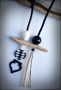 Long original necklace with driftwood, black onyx and synthetic beads