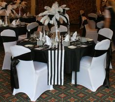 Gatsby style black and white feather centrepiece, Eiffel Tower arrangement. Hire in The Midlands from Make It Special Events. http://www.makeitspecialevents.co.uk/