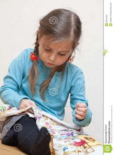 Little girl embroidering