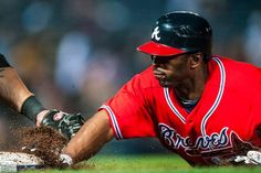 SAFE! Michael Bourn dives back to first base.    (Photo by Pouya Dianat/Atlanta Braves/Getty Images)