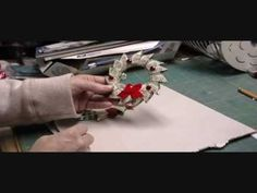This video shows how to make a wreath out of 15 one dollar bills.