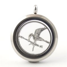 Ahhh! Mockingjay floating locket disc from Spiffing Jewelry!