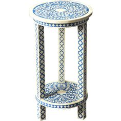 Rest a cup of tea beside the sofa or display a lantern in the three-season room with this eye-catching end table, showcasing bone inlay and a blue botanical ...