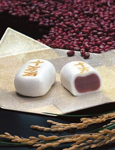 Japanese sweets, Manju (饅頭 まんじゅう?) is a popular traditional Japanese confection. There are many varieties of manjū, but most have an outside made from flour, rice powder and buckwheat and a filling of an (red bean paste), made from boiled azuki beans and sugar. They are boiled together again and kneaded; varieties of bean paste use include koshian, tsubuan, and tsubushian.