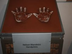 Put your hands in Nelson Mandelas hands and feel moved by a man that changed the world.