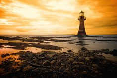 Lighthouse on the Gower Peninsula, Wales  One of only two iron lighthouses in the world .