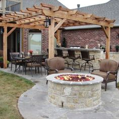 Like this patio. Pergola & fire pit.this is shaped kind of like your back yard