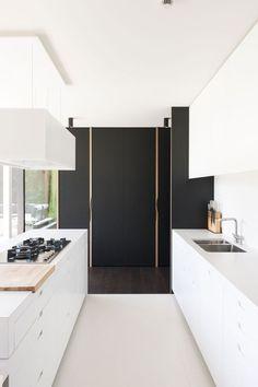 Bright white parallel kitchen - DMOA Architects