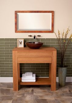 Sumatra Vanity: Handcrafted from solid, sustainable bamboo with integral top, and a flush soft-close drawer. The warm tones of the bamboo and the clean lines make this contemporary and sustainable piece perfect for your eco-conscious design. Integral top coordinates with any surface mounted sink or add any of our stone tops to combine with any Native Trails sink. Shown with Laguna in Antique and Milano Mirror in Tempered.