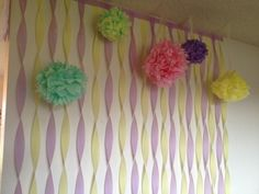 Party decorations: streamers and DIY flower puff balls