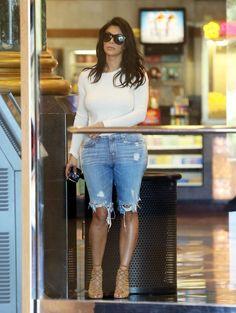Reality star Kim Kardashian her rapper husband Kanye West enjoy a Sunday movie date in Calabasas, California on October 19, 2014.