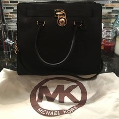 Large Michael Kors Saffiano Black Hamilton ❗️No Trades, 100% Authentic .. Still stiff, and in EXCELLENT condition! No wear especially under the lock! Comes with Dustbag.. Make an offer  Michael Kors Bags