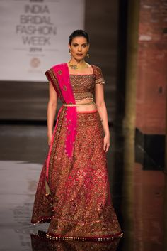 Traditional pink Indian bridal lehnga with gold belt by JJ Valaya at India Bridal Fashion Week. More here: http://www.indianweddingsite.com/bmw-india-bridal-fashion-week-ibfw-2014-jj-valaya/