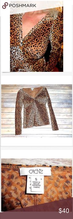 CACHE Long Sleeve Black & Cheetah Low Cut Blouse! CACHE Long Sleeve Black & Cheetah Low Cut Blouse! Small 60% spandex & 30% polyester & 10% spandex Great Used! Cache Tops Blouses