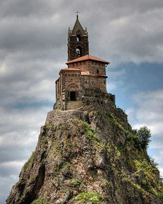 Saint-Michel d'Aiguilhe is a chapel in Aiguilhe, near Le Puy-en-Velay, France, built in 969 on a volcanic plug 85 metres (279 ft) high. The chapel is reached by 268 steps carved into the rock. It was built to celebrate the return from the pilgrimage of Saint James.