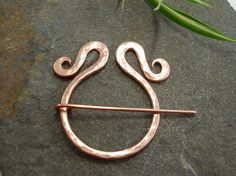 Hey, I found this really awesome Etsy listing at https://www.etsy.com/listing/168821141/penannular-brooch-textured-copper-small