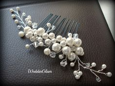 Bridal Hair Comb, Wedding Hair Accessories, Swarovski pearls crystals, Rhinestones, Hand-wired, Ivory Elegant Headpiece, White flower comb. $35.00, via Etsy.