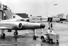 A jet fighter (in the foreground) is towed by Avro& hanger in Malton, . Military Jets, Military Aircraft, Avro Arrow, Russian Bombers, Avro Vulcan, New Aircraft, Experimental Aircraft, Aircraft Design, Military History